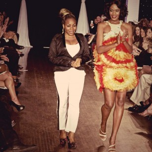 Designer Funkside Eniola of Studio Alade with model at Next Fashion 2012 runway show at Germania Place during Fashion Focus Week Chicago.