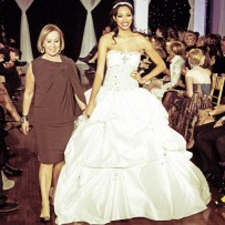 Designer Mira Horoszowski with model wearing a couture bridal gown at Next Fashion 2012 runway show at Germania Place during Fashion Focus Week Chicago.